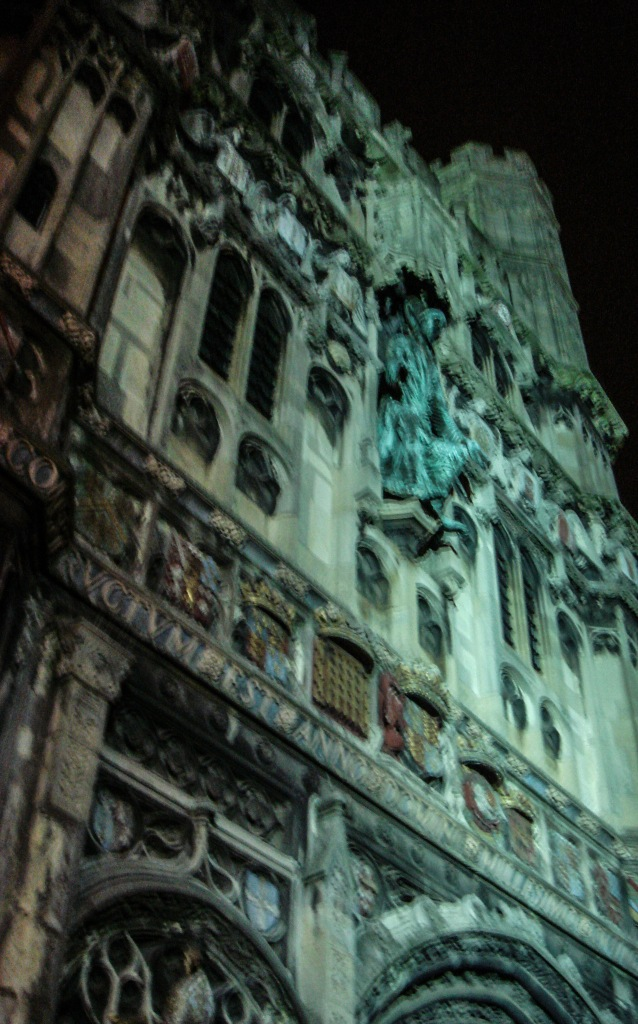 City lights reflect on the exterior of Canterbury Cathedral