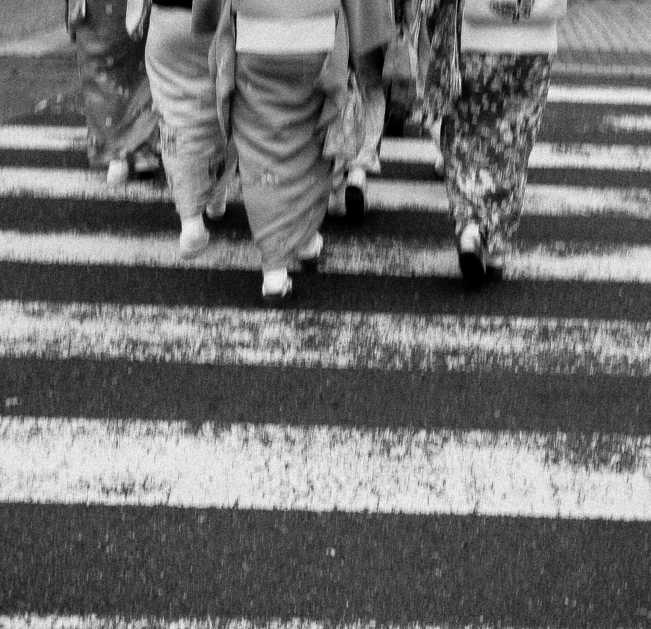 A group of geisha women cross the street in Kyoto
