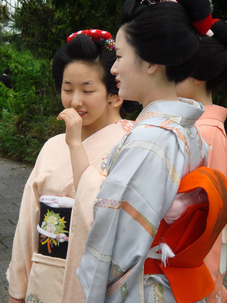 A group of geisha women chat together in Kyoto