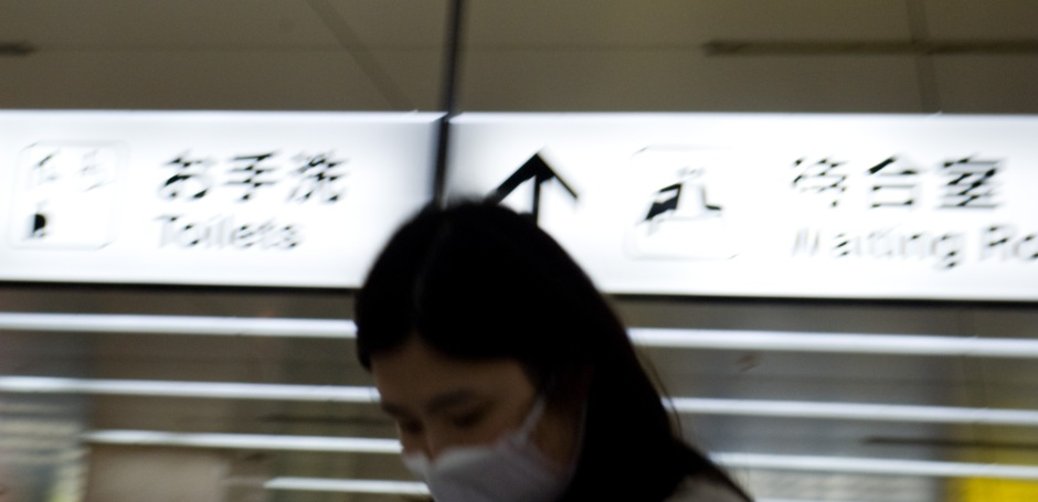 A young woman protects herself with a surgical mask in a subway in Osaka