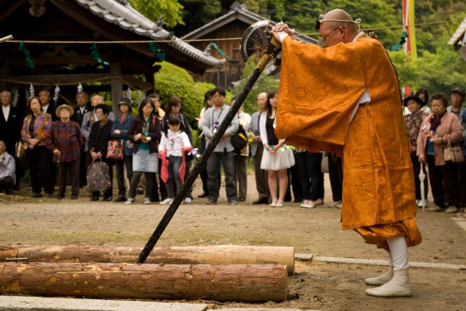 A Shinto priest prepares for a spring ceremony