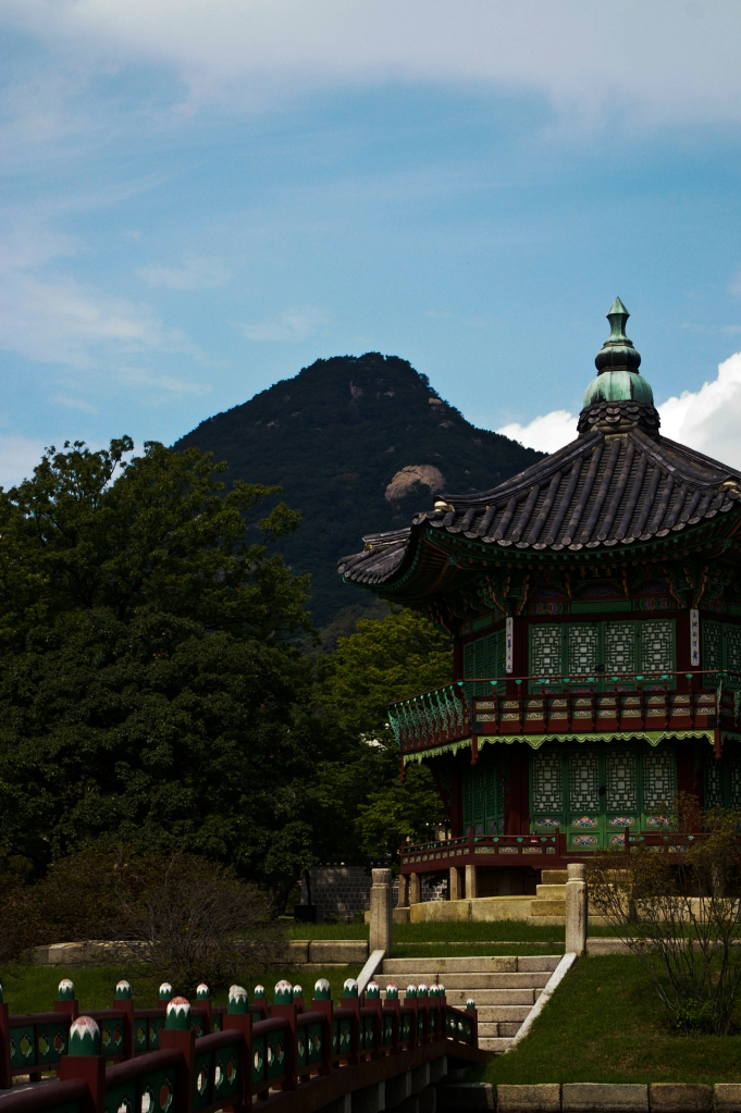 A palace building seen against a nearby mountain