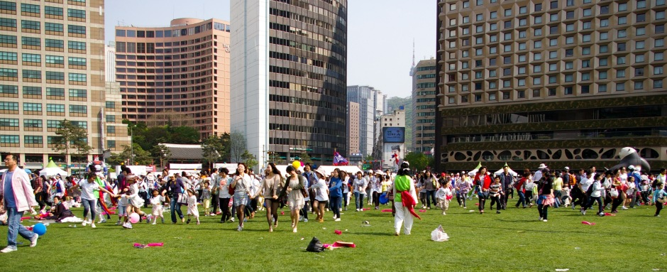 A holiday event has parents and children running around at City Hall in Seoul