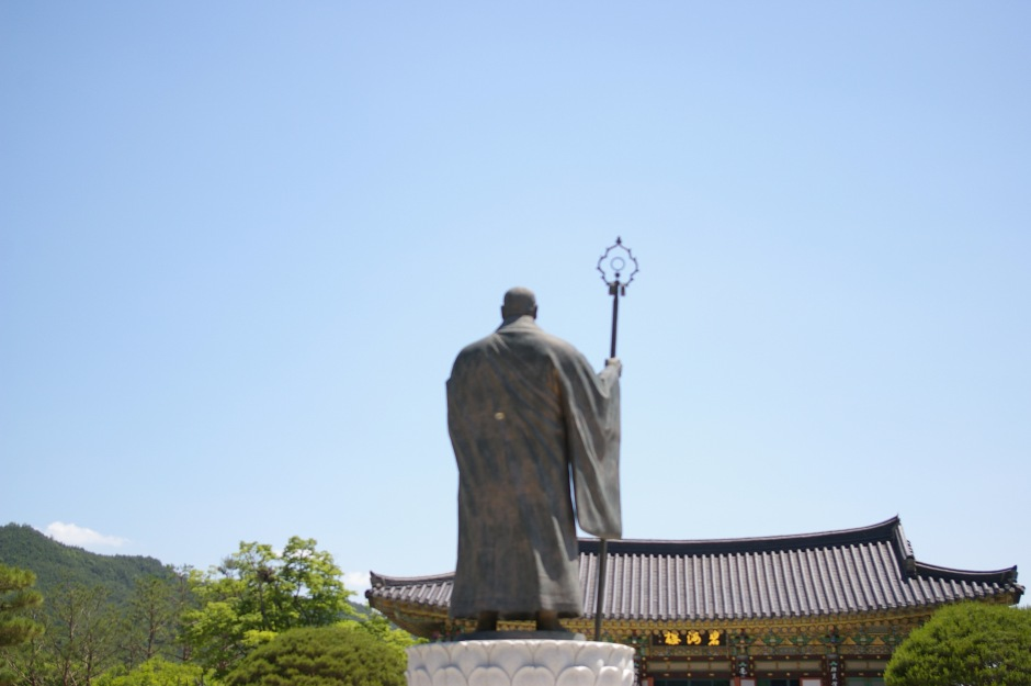 A statue watches over a Buddhist temple