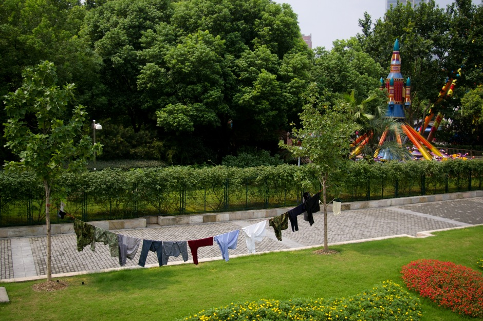 A line of laundry dries outside of a children's theme park in Shanghai