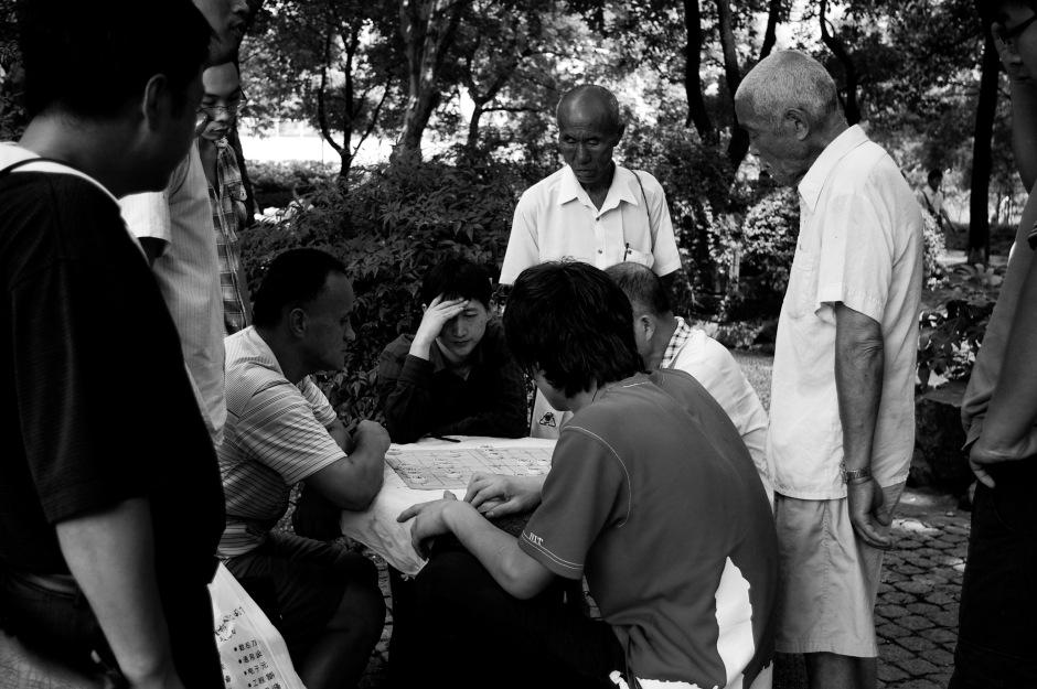 Men play games in Century Park, Shanghai
