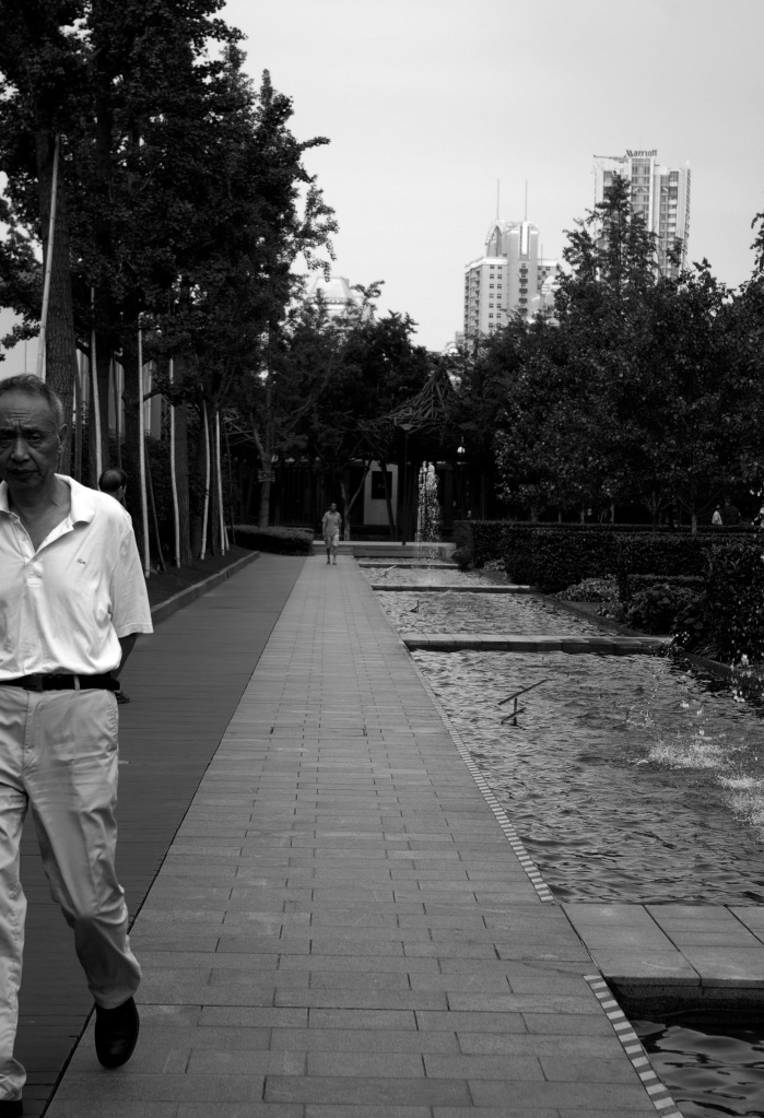 A man strolls through the Jing'an Sculpture Park