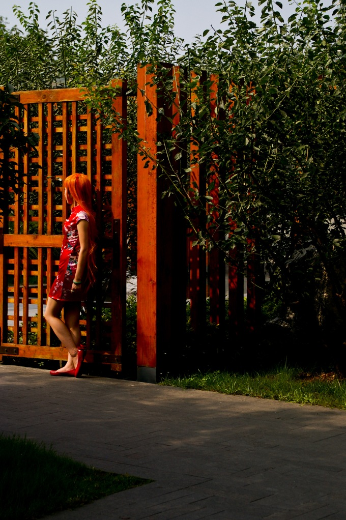 A young woman poses in costume in the Jing'an Sculpture Park