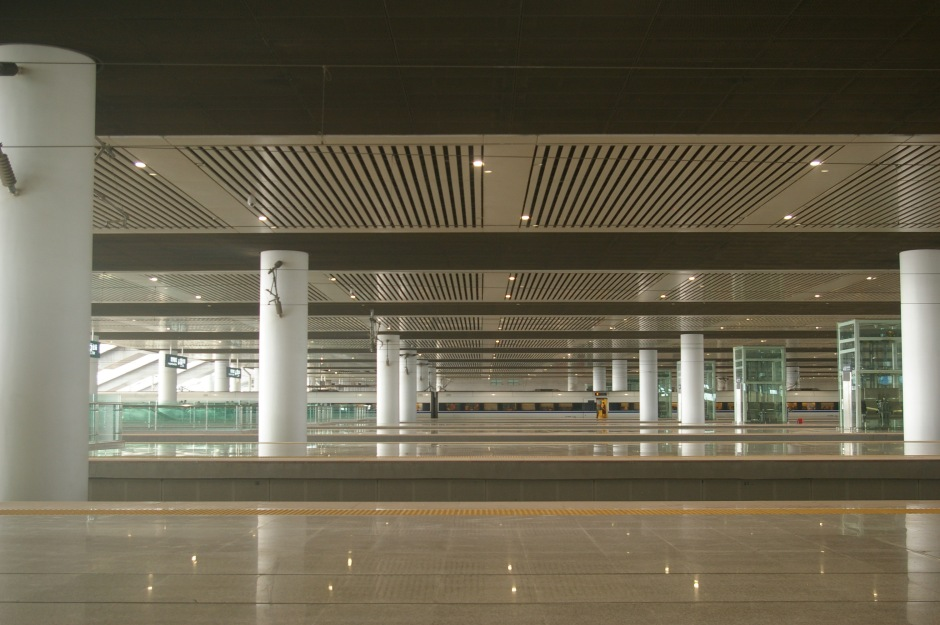 A gleaming, empty high-speed train station in China