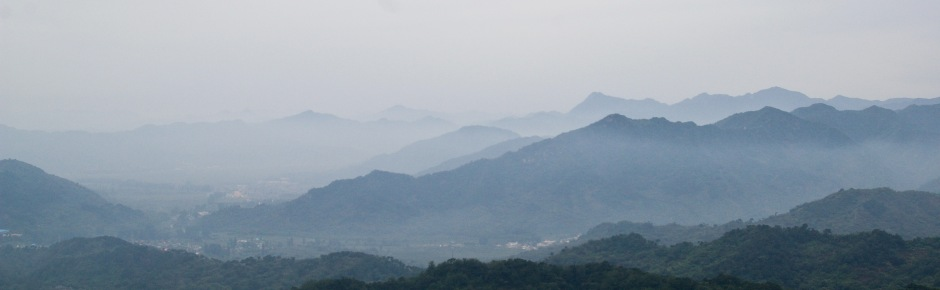 Misty mountains surrounding the Great Wall of China